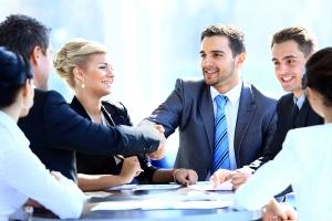 bigstock-Two-business-colleagues-shakin-45670564