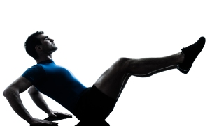 one caucasian man exercising workout fitness in silhouette studi