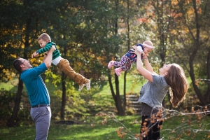 Happy family having fun outdoors in autumn park